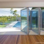 Multi-fold glass walls on poolside