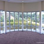 View of lake from indoors with glass doors