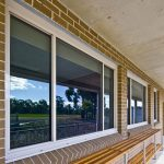 Glass windows installed on brick walls