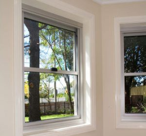 White walls with glass windows and awnings